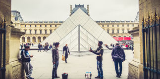 Water sellers near Louvre Museum Stock Images