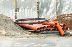 Water or sewage pipes on the street reconstruction site for new pipeline system to be built in the building construction Royalty Free Stock Photos