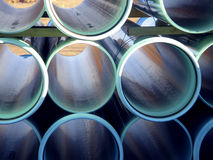 Water or sewer pipes. Stacked in storage area Stock Photo