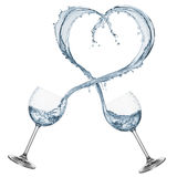 Water shaped heart. Glasses pouring water that forming a heart shape, isolated on white Royalty Free Stock Photography