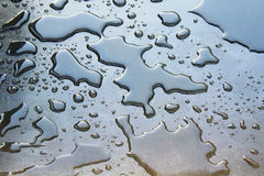 Water shapes. Water on the granite surface Royalty Free Stock Image