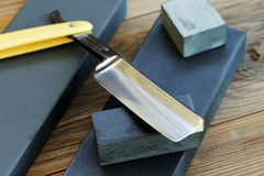 Water sharpening stones and cutthroat razor.  stock photography