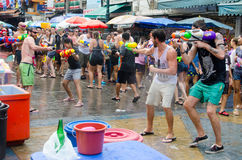 Water shootout. Bangkok, Thailand, 13 April 2015. Festival goers battle it out with water guns during the annual Songkran water festival in Khao San Road Royalty Free Stock Photography