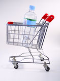 Water shopping cart. View of a shopping cart with bottled water Royalty Free Stock Photo