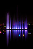 Water show. Beautiful colored water show with fountains,reflection and music Royalty Free Stock Images