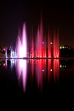 Water show. Beautiful colored water show with fountains reflection and music Royalty Free Stock Photo