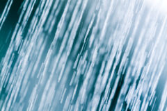 Water from shower in blue tone Stock Photography