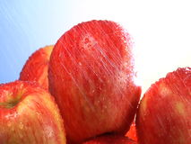 Water showers on stack red apples stock footage