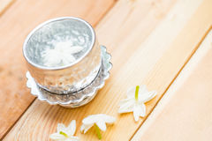Water in silver bowl with Jasmine flower. Jasmine flower on silver tray, Thai white flower on wood background Royalty Free Stock Image
