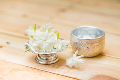 Water in silver bowl with Jasmine flower. Jasmine flower on silver tray, Thai white flower on wood background Stock Images