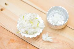 Water in silver bowl with Jasmine flower. Jasmine flower on silver tray, Thai white flower on wood background Stock Photo