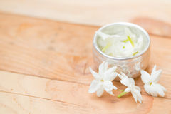 Water in silver bowl with Jasmine flower. Jasmine flower on silver tray, Thai white flower on wood background Stock Photography