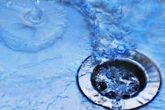 Water in sink. Close up of  sink with water drops Royalty Free Stock Photography
