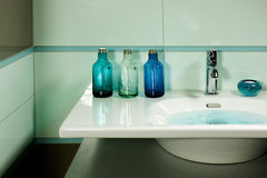 Water in Sink. Blue modern bathroom in a house Royalty Free Stock Photos
