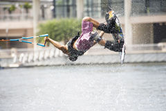 Water Ski In Action: Man Wakeboard Tricks Stock Image
