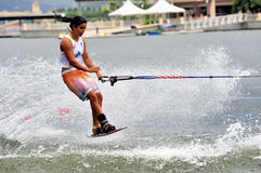 Water Ski In Action: Woman Shortboard Tricks Stock Image