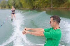 Water ski coach giving advise to student. Water ski coach giving advise to his student Royalty Free Stock Images