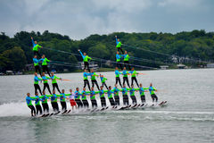 Water Ski Pyramid. A water skiing team form a four person high triple pyramid at the Aquanuts ski show in Twin Lakes, Wisconsin in Kenosha County Royalty Free Stock Image