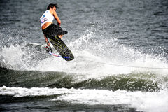 Water Ski World Cup 2008: Man Shortboard Tricks. From 7 to 9 November 2008, the International Water Ski Federation (IWSF) staged its 25th Waterski World Cup Stop Royalty Free Stock Image