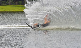 Water Skier Falling. A teenage boy water skiing during a tournament, falling on the course royalty free stock image