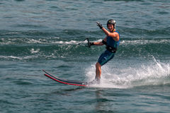 Water skier waves hello. Water skier skiing on lake and waves hello to me Royalty Free Stock Photography