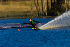 Water Skiing Athlete Carving Spray. Male athlete water skier carving round the yellow orange marker buoy during the South Africa national water champs on a good Royalty Free Stock Photos