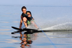 Water skiing. Athlete to ski glides over the waters stock photo