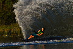 Water Skiing Athlete Water Spray. Male athlete water skier carving round the yellow marker buoy during the South Africa national water champs on a good well Royalty Free Stock Images