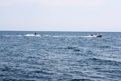 Water skiing by boat on the sea stock photography