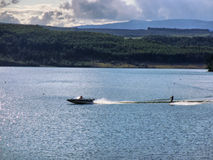 Water skiing on lake Stock Images