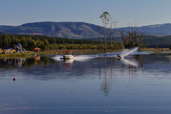 Water Skiing Slalom Landscape. Male skier slalom carving a nice turn in a scenic area of South-Africa Royalty Free Stock Photography