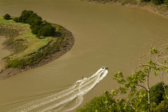 Water Skiing on the River Wye, Wintour's Leap. Water skiing on the brown, tidal River Wye from the limestone cliffs of Wintour's Leap, at Woodcroft Royalty Free Stock Photo