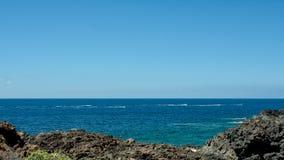 Water skiing on the sea near the coast stock image