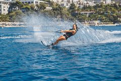 Water skis glides on the waves, female athlete on Aegean Sea, Greece Stock Images