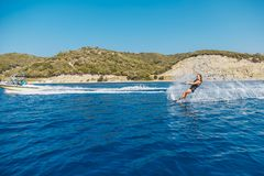 Water skis glides on the waves, female athlete on Aegean Sea, Greece Stock Photography