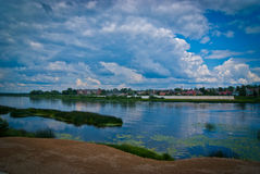 Water and sky. Beautiful landscape with river, city and sky Stock Photos