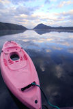 Water and sky. Canoe in the water reflection background royalty free stock photography