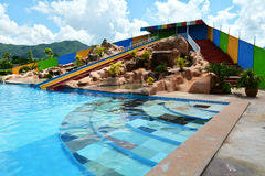 Water slide. Colorful water slide with swimming pool royalty free stock photography