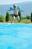 Water slide fun on outdoor pool Stock Images