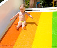 Water slide fun on outdoor pool Stock Photo