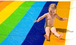 Water slide fun on outdoor pool Stock Image