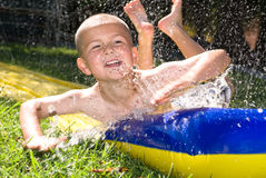 Water slide and kid Stock Image