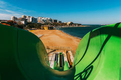 A water slide in an open water park near the sea against the backdrop of Gelendzhik Bay, a first-person view. Gelendzhik, Russia Royalty Free Stock Image
