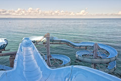Water slide by the sea Royalty Free Stock Image
