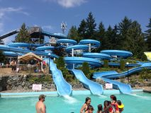 Water Slide. Spiral water slide in water park. Everyone has tons of fun Royalty Free Stock Photo