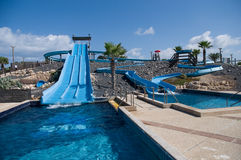 Water slide in the theme park . Water park view , with slides and swimming pool stock photos
