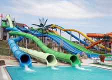 Water slide in water park. Woven together three pipes in the water park Royalty Free Stock Photos