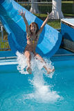In the water slides. Pretty young girl joy in the water slides Stock Photo