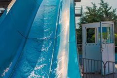 Water slides, attractions of blue color in the park. stock image
