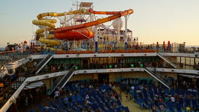 Water slides on the Carnival Breeze. Docked in Miami, Florida. The Breeze is a Dream-class cruise ship owned by Carnival Cruise which entered service in June Stock Photography